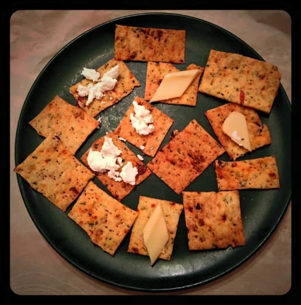 Tomato Basil Cracker on Plate with Toppings